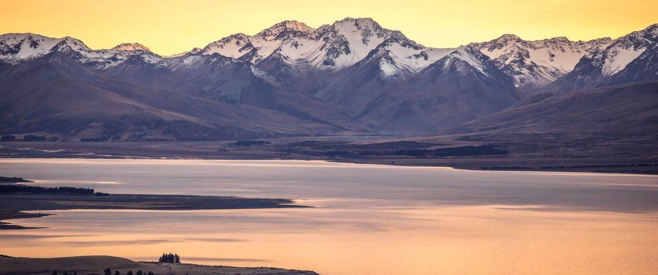Lake Tekapo New Zealand and mountain range in sunrise