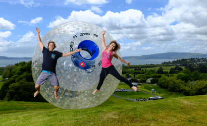 Man and woman jumping in before zorbing rotorua