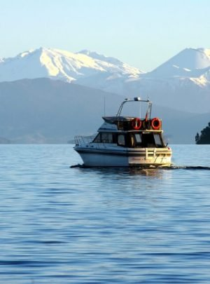 scenic cruises boat on lake taupo new zealand with mt tongariro