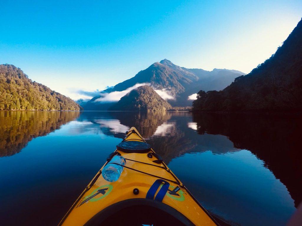 Yellow kayak in Milford Sound New Zealand