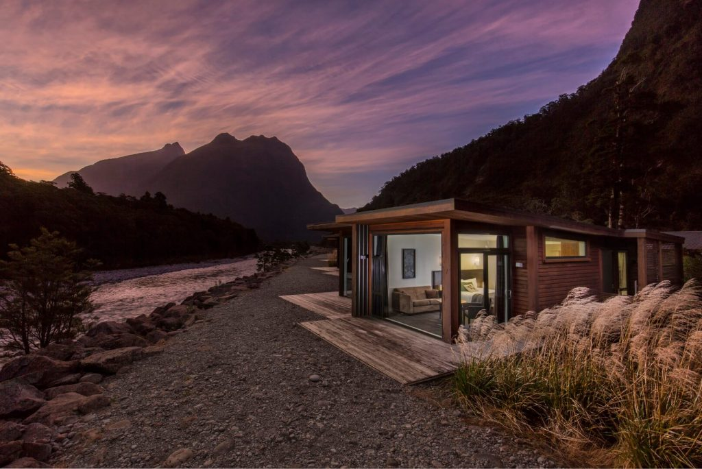 Riverside Chalets at Milford Sound Lodge in Fiordland during sunset