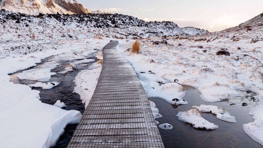 Tongariro Winter Crossing with Adrift Tongariro wooden walkway through the snow
