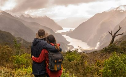 Couple looking over Doubtful Sound from Wilmont Pass with Real Journeys