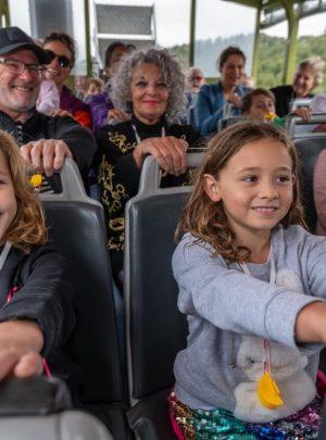 Kids and adults holding on as the Rotorua Duck does a spashdown into Lake Okareka. Rotorua Duck Tours New Zealand
